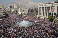Thousands of Syrians rally to show their